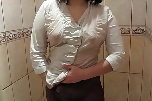 Girl in a washed out blouse, in black pantyhose masturbates in the shower to orgasm.