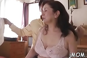 Mature playgirl plays with water