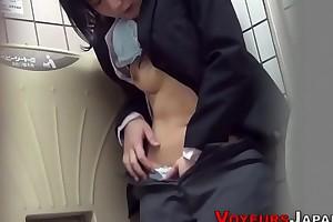 Asian babe rubs up public