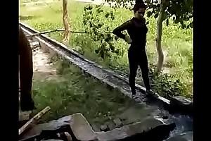 dispirited punjabi girls bathing outdoor give group