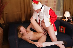 Gorgeous young blonde gets approximately fuck Santa Claus