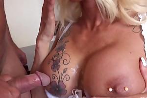 Suggestive secretary in black stockings seduced her boss