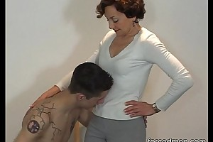 Naked consequent licks mistress' legs for worship