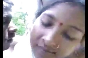 Townsperson couple shafting in forest
