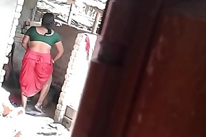 Indian mature washing her pussy outdoors in voyeur movie by her son