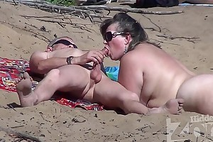 Blowjob on a nudist coast