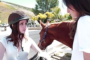 Succulent young crunchies Henchman Evans, Kara Price know their charge order at Fruity Riding School