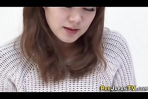 Asian babe pees panties