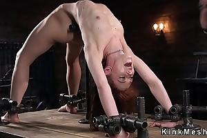 Skinny slave in metal bondage agonizing
