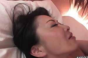 Hairy Japanese chick with big tits pussy drilled missionary style