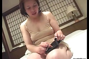 Asian granny inserts a marital-device with regard to her honour gouge out