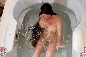 Longhaired blond milf dunking head in water
